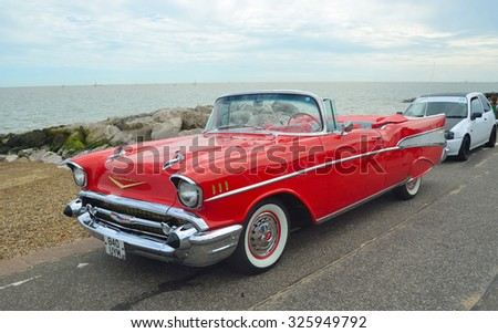 FELIXSTOWE, SUFFOLK, ENGLAND - AUGUST 29, 2015: Classic Red Chevrolet Belair convertible on show on Felixstowe seafront. - stock photo