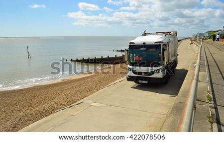 FELIXSTOWE, SUFFOLK, ENGLAND - MAY 03, 2016: Refuse collection truck on seafront promenade Felixstowe Suffolk England.  - stock photo