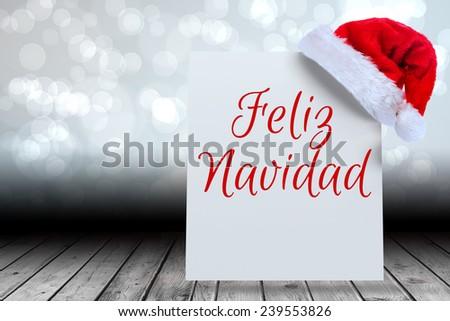 Feliz navidad against santa hat on poster - stock photo