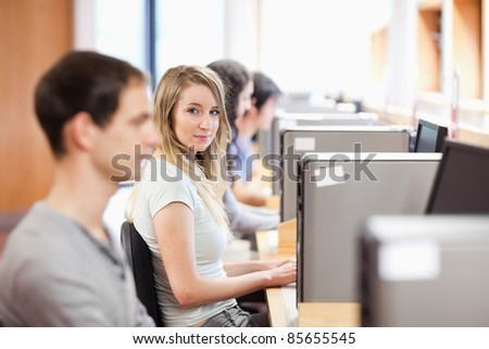Fellow students using a computer in an OT room - stock photo