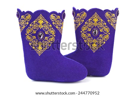Felt boots with ornament isolated on white background - stock photo