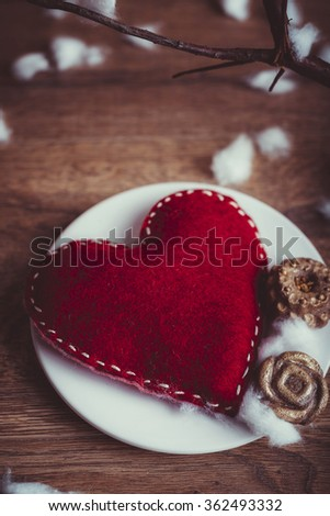 Felt heart on wooden background/Love concept - stock photo