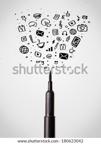 Felt pen close-up with sketchy social media icons - stock photo