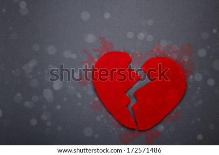 Felt red broken heart on gray background - stock photo