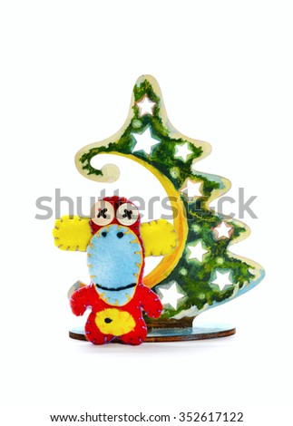 Felt  red monkey and Christmas tree. Isolated on white background