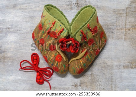 felted boots with poppies - stock photo