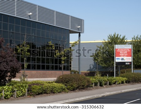Feltham, Central Way, London, Middlesex, England - September 10, 2015: Estate agents industrial warehouse units to let sign  - stock photo