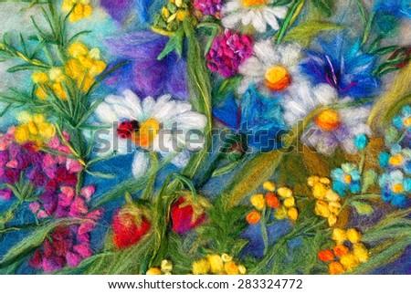 felting wool - contemporary art - handmade. A single unique piece. Painting with wild flowers - daisies, cornflowers, grass, strawberry, ladybird. - stock photo