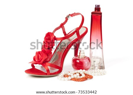 Female accessories with red shoe isolated on white