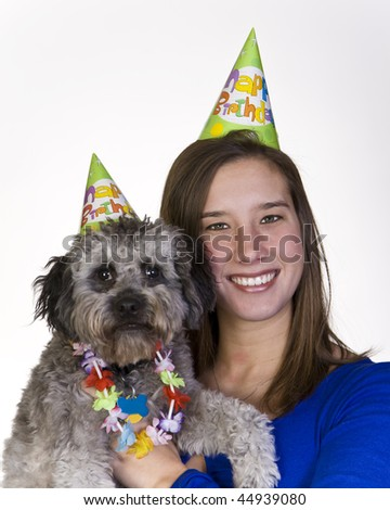 Female and her dog celebrate a birthday