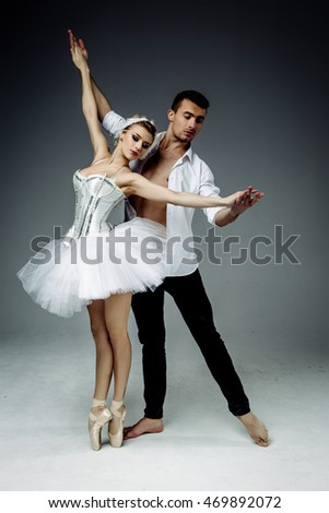 Female and male  classic ballet dancers posing