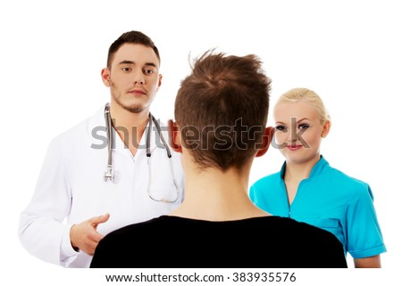 Female and male doctors and patient  - stock photo