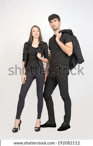 female and male fashion models wearing black clothes  - stock photo
