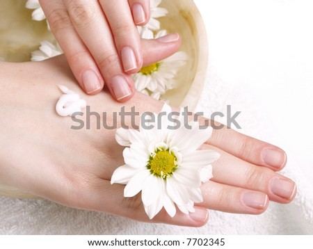 female applying cream to her hands - stock photo