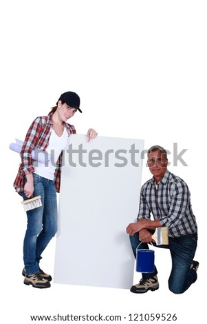 female apprentice with mature mentor - stock photo