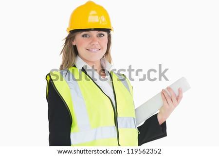 Female architect holding a plan and smiling - stock photo