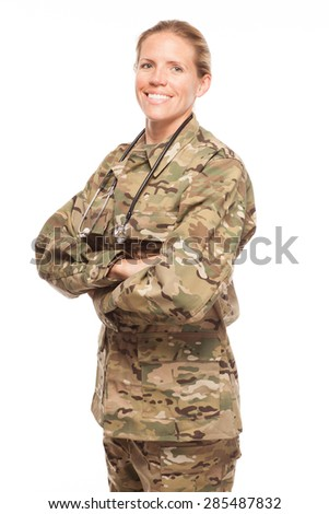 Female Army doctor or nurse in uniform on white background.  Female US Soldier in the medical field smiling. - stock photo