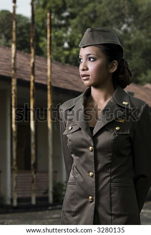 Female Army Personnel in an old barrack looking at a direction - stock photo