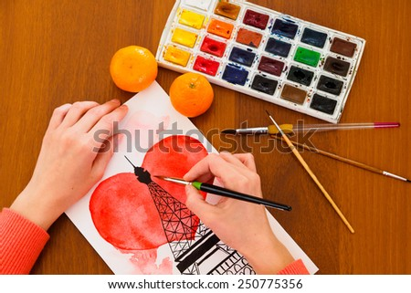 Female artist painting Eiffel tower - stock photo