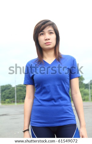 female asian athlete with facial expression of determination - stock photo