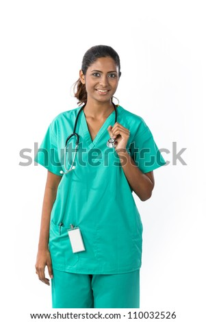 Female Asian doctor wearing a white coat and stethoscope. Isolated on white. - stock photo
