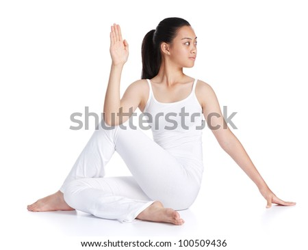 female asian teenager exercising yoga against white background - stock photo