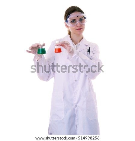 Female assistant scientist in white coat and plastic protective glasses over white isolated background apprehensively holding flasks with substance, healthcare, profession, science and concept