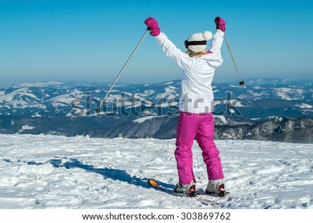 Female at ski stay on the top of mountain with beautiful view - stock photo