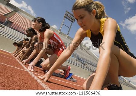 Female athletes at starting line - stock photo