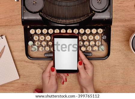 female author are holding the phone with blank screen  in hand - stock photo