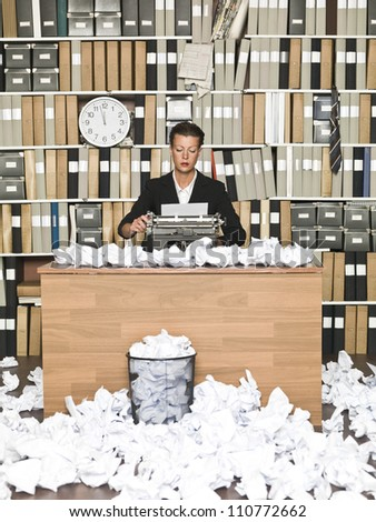 Female Author at a messy office - stock photo