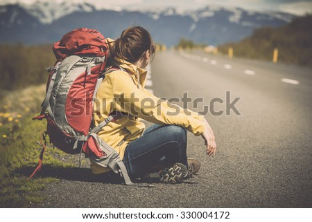 Female backpacker tourist in Icleand ready for adventure