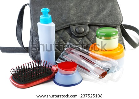 Female bag and cosmetics isolated on a white background - stock photo