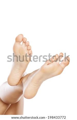 female bare feet on white background - stock photo