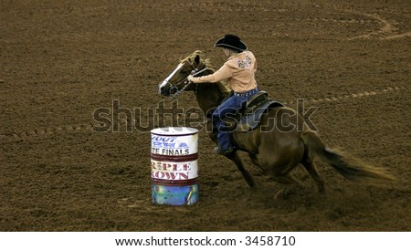 Female barrel racer - stock photo