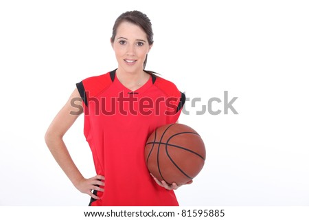 Female basketball player standing on white background - stock photo