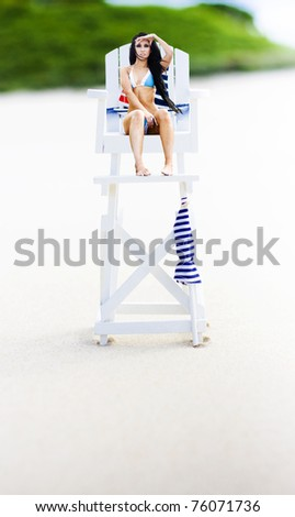 Female Beach Lifeguard Sitting On A Large Wooden Life Guard Chair Watching Out For The Safety And Protection Of Ocean Swimmers - stock photo