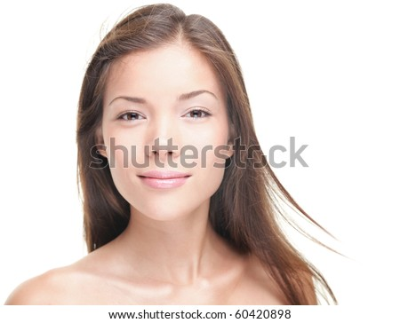 Female beauty portrait. Beautiful young woman - pure natural beauty. Close-up portrait of mixed race Asian / Caucasian female model. Isolated on white background. - stock photo