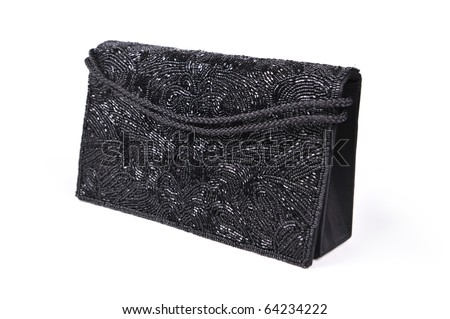 Female black evening clutch embroidered with beads - stock photo