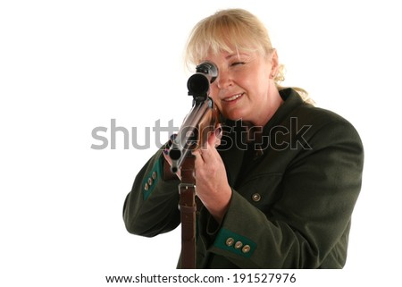 Female blonde huntress going hunting - stock photo