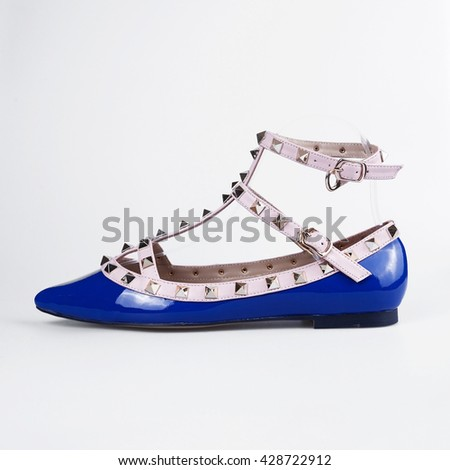 Female blue shoes over white