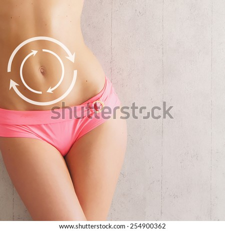 Female body with the drawing arrows on it isolated on white. Fat lose, liposuction and cellulite removal concept. - stock photo