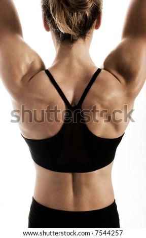 female bodybuilder's muscular back - stock photo