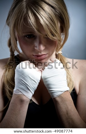 female boxer in a fighting pose