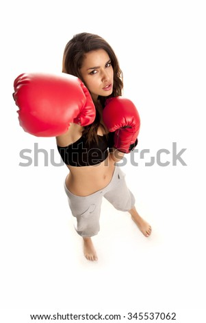Female boxer over a white background.
