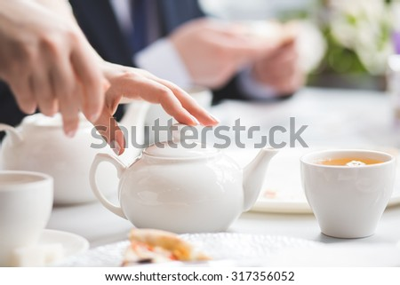 Female brews. The picture was taken during tea party. - stock photo