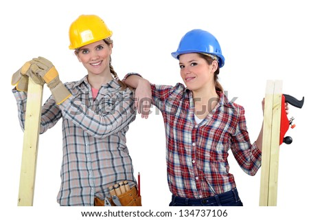Female builders with timber - stock photo