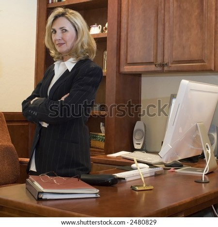 female business executive is in her office - stock photo