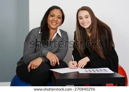 Female Business Team of Mixed Races at Office - stock photo