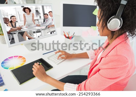 Female business woman giving a presentation against casual female photo editor using computer - stock photo